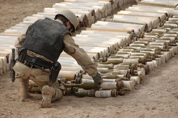 A U.S. Navy Explosive Ordnance Disposal (EOD) technician places C4 explosives on Chinese 82mm Type 65 Recoilless Rifles, and 82mm High Explosive Anti Tank (HEAT) Recoilless Rifle Rounds near the Kandahar International Airport in Afghanistan. (Photo: U.S. Navy/Photographer's Mate 1st Class Ted Banks)