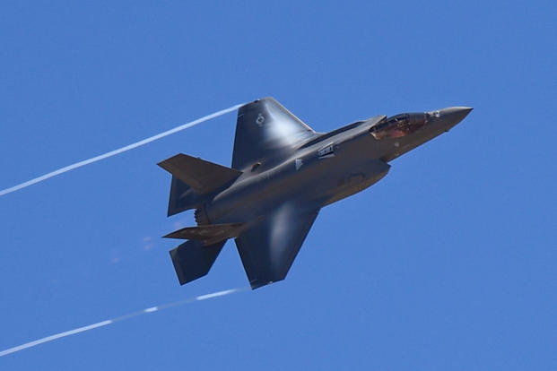 An F-35A Lightning II from the 388th Fighter Wing flies over the Warriors Over the Wasatch Air and Space Show June 24, 2018, at Hill Air Force Base, Utah. The F-35 was part of a four-ship participating in an attack demonstration. (U.S. Air Force photo/Todd Cromar)