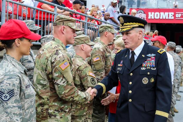 Lt. Gen. John M. Murray speaks with Soldiers and Airmen before kickoff of Ohio State-Army game Sept. 16, 2017, at Ohio Stadium in Columbus, Ohio. (Ohio National Guard/Staff Sgt. Michael Carden)