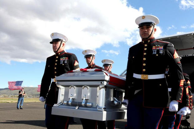 U.S. Marines carry the remains of Lance Cpl. Joe Jackson at the Yakima Air Terminal, Wash., on May 2, 2011. Jackson was killed April 24, 2011, in Afghanistan. (US Marine Corps photo/Jad Sleiman)