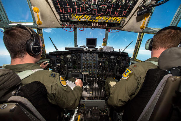 Capt. Scott Duguay, the aircraft commander, and Maj. John Chrampanis, the instructor pilot, both with the 118th Airlift Squadron, Bradley Air National Guard Base, Connecticut, fly a C-130 Hercules with simulated medical patients from Fort McCoy, Wisconsin to Cincinnati Northern Kentucky International Airport during Patriot North 18 July 18, 2018. (U.S. Air National Guard photo/Cameron Lewis)