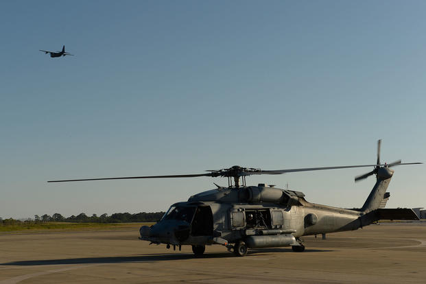 A U.S. Navy HH-60H Seahawk helicopter assigned to Helicopter Sea Combat Squadron (HSC) 84 taxis across the flight line at Hurlburt Field, Fla., May 6, 2014, during exercise Emerald Warrior 2014. (U.S. Air Force photo/Tim Chacon)