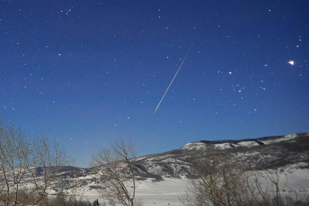 A meteor streaks through the night sky. (Photo: NASA)