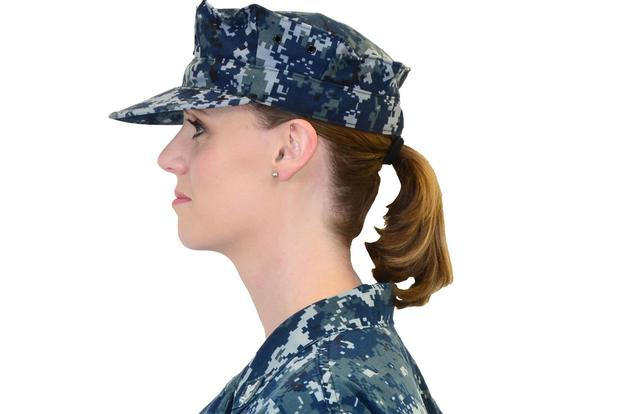 The end of the braid or ponytail may extend up to three inches below the lower edge of the collar of the shirt, jacket or coat. (U.S. Navy/Riley Eversull)