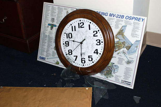 A clock, frozen at the time of impact, inside the Pentagon. (Air Force photo by Staff Sgt. Larry A. Simmons)