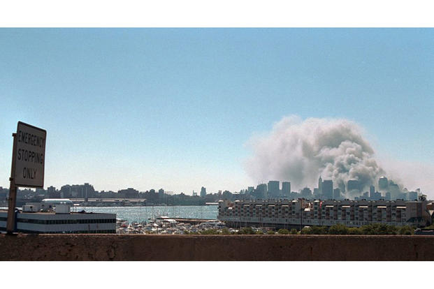 Smoke rises from the site of the World Trade Center, Sept. 11, 2001. (Photo by Paul Morse, courtesy of the George W. Bush Presidential Library)