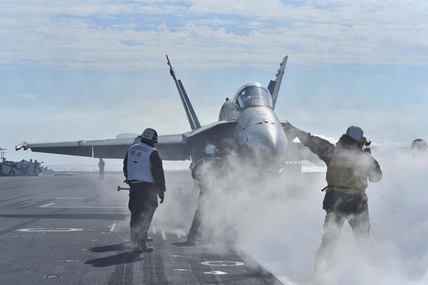An F/A-18C Hornet assigned to the Salty Dogs of Strike Aircraft Test Squadron (VX) 23 tests the Joint Precision Approach Landing System (JPALS) aboard the aircraft carrier USS Theodore Roosevelt. (U.S. Navy/Mass Communication Specialist Seaman Stephane Belcher)