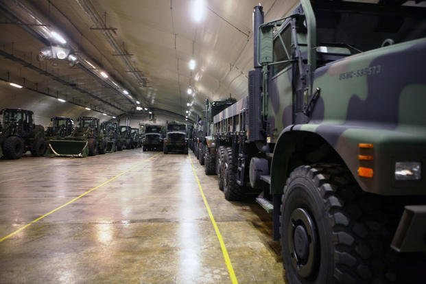 Rows of front loaders and 7-ton trucks sit, gassed up and ready to roll in one of the many corridors in the Frigard supply cave located on the Vaernes Garrison near Trondheim, Norway, Jan. 6, 2012. (U.S. Marine Corps photo/Matt Lyman)