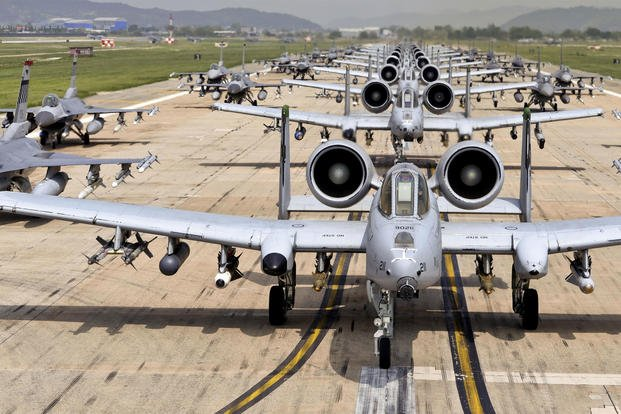 """A-10 Thunderbolt IIs and F-16 Fighting Falcons perform an 'elephant walk' on the runway at Osan Air Base, Republic of Korea. The A-10s are the 25th Fighter Squadron """"Draggins"""" and the F-16s are the 36th Fighter Squadron """"Fiends"""" from the 51st Fighter Wing. Additional F-16s are the 179th Fighter Squadron """"Bulldogs"""" from the 148th Fighter Wing out of Duluth Air National Guard Base, Minnesota. (US Air Force photo/Travis Edwards)"""