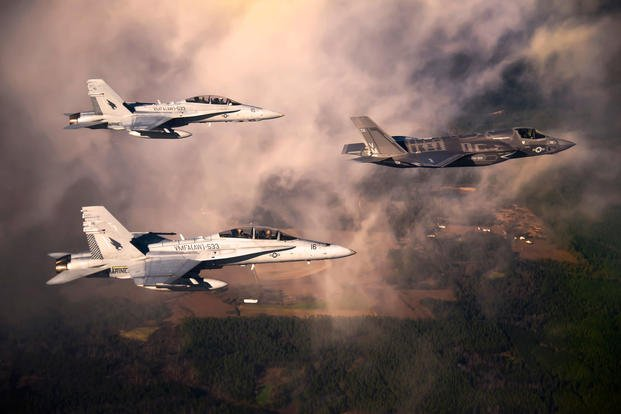 DoD's first production F-35B Lightning II joint strike fighter flies toward its new home at Eglin Air Force Base, Fla., escorted by Marine Corps F-18 Hornets, Jan. 11, 2011. (U.S. Air Force photo/Joely Santiago)