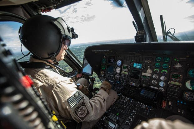 a cbp air interdiction agent patrols the sky in a uh 60 black hawk helicopter photo by josh denmark courtesy of cbp