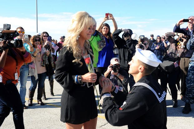 A sailor proposes at homecoming. (U.S. Navy)