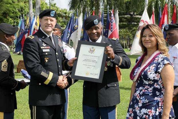Lt. Col. Antonio Copeland receives his certificate of retirement from Maj. Gen. Pete Johnson, U.S. Army Pacific deputy commanding general-south, during a celebration of service ceremony. (U.S. Army/Justin Silvers)