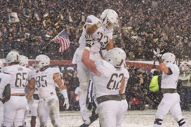 Darnell Woolfolk, #33, celebrates scoring a touchdown during the Army-Navy football game in Philadelphia, Dec. 9, 2017.