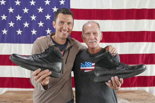 Jason McCarthy and Richard Rice display GORUCK's MACV-1 boot in front of an American flag. (Courtesy Photo)