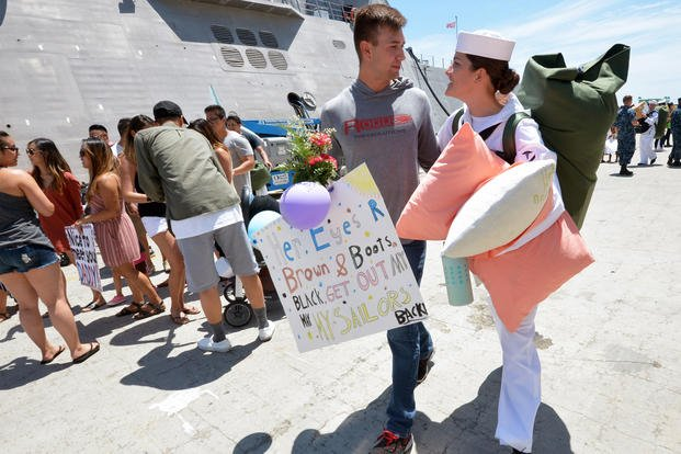 Hospital Corpsman 3rd Class Haley Buyense is greeted by Master-at-Arms 2nd Class Paul Peargen during a 2018 homecoming ceremony for the Military Sealift Command (MSC) hospital ship USNS Mercy. (U.S. Navy/Indra Beaufort)