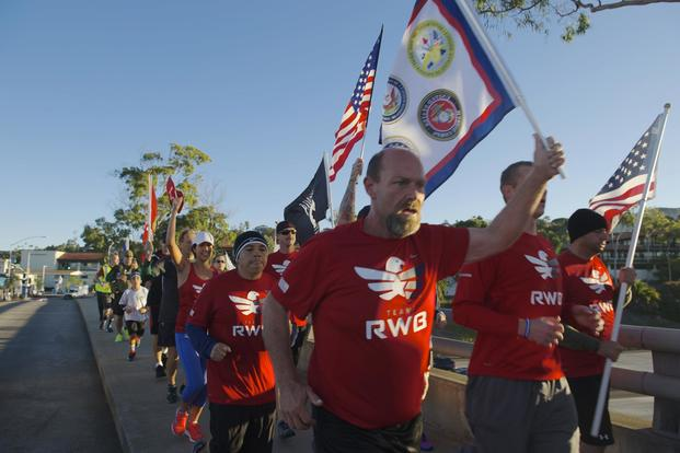 Active duty service members, veterans and their families run the streets of San Diego during a Team Red, White and Blue (RWB) hosted Veterans Day run. (U.S. Navy/Mass Communication Specialist 3rd Class Gerald Dudley Reynolds)