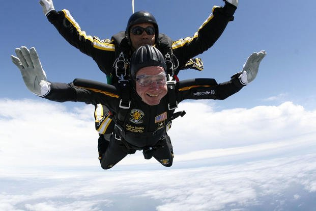 Former President George H.W. Bush jumps with the U.S. Army Parachute team, the Golden Knights, on his 90th Birthday. (U.S. Army photo)
