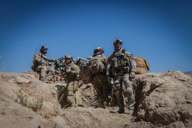 U.S. Special Forces Soldiers and an Afghan agents from the NMRG scan their surrounding area after a firefight with the Taliban during an operation in the Tagab district, Kapisa province, Afghanistan, Sept. 20, 2016. (U.S. Army/Sgt. Connor Mendez)