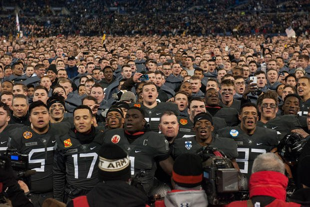 8c72f4407 Army West Point Football fans join the team on the field for the alma mater  during