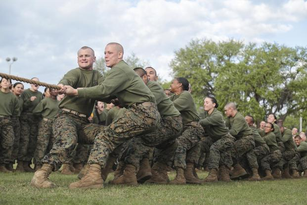 U.S. Marines with Fox Company, 2nd Battalion, and Oscar Company, 4th Battalion, Recruit Training Regiment, take part in Tug-of-War during the Field Meet at 4th Recruit Training Battalion physical training field on Marine Corps Recruit Depot, Parris Island, S.C., April 21, 2018. (U.S. Marine Corps/Cpl. Sarah Stegall)
