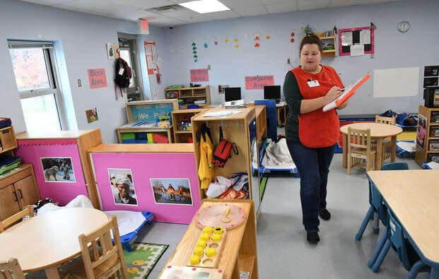 Cali Cobb walks through the Po Valley Child Development Center on Fort Drum, New York. (Mike Strasser/U.S. Army)