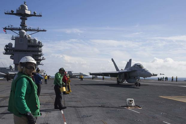 "An F/A-18F Super Hornet, assigned to the ""Swordsmen"" of Strike Fighter Squadron 32, approaches USS Gerald R. Ford's Electromagnetic Aircraft Launching System (EMALS) during flight deck operations on Nov. 6, 2017, as part of testing and evaluations on the ship. (U.S. Navy photo by Mass Communication Specialist 2nd Class Kristopher Ruiz)"