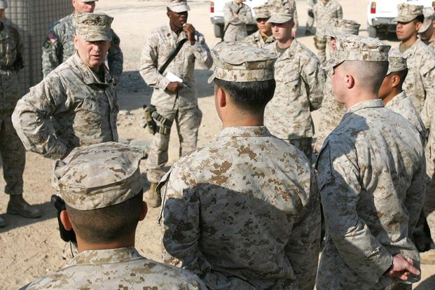 Then-Lt. Gen. Jim Mattis, head of U.S. Marine Forces Central Command and 1st Marine Expeditionary Force, speaks with Marines from Security Platoon, Headquarters and Support Company, 1st Marine Logistics Group (Forward), during a visit to Camp Taqaddum, Iraq, on Dec. 9, 2006. (U.S. Marine Corps photo by Lance Corporal Ryan L. Tomlinson)
