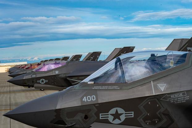 "Ten F-35C Lightning II jets of the ""Argonauts"" of VFA-147 aircraft sit on the flight line at Naval Air Station Lemoore. (U.S. Navy/Mass Communication Specialist 2nd Class Manuel Tiscareno)"