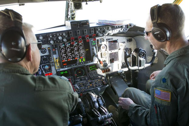 Lt. Col. Eric Wilks (left) and Lt. Col. Marvin Ashbaker, pilots with the 465th Air Refueling Squadron at Tinker Air Force Base, Oklahoma, conduct pre-flight checks aboard the Air Force Reserve Command's first KC-135 Stratotanker to receive the Block 45 upgrade in 2016. (U.S. Air Force photo/Lauren Gleason)