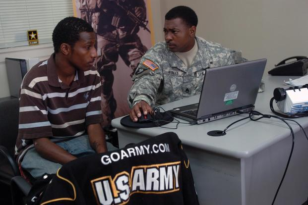 Staff Sgt. Roger L. Whaley speaks with Phillip McDonald about the possibility of becoming a journalist or X-ray technician for the Army at the U.S. Army Recruiting Station in Radcliff, Ky. (U.S. Army/Sgt. Carl N. Hudson)