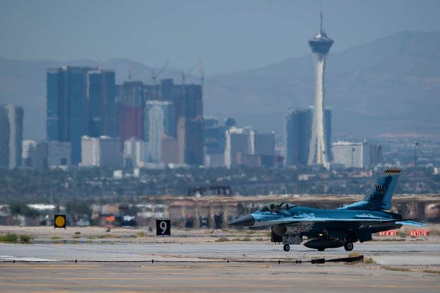 An F-16 Fighting Falcon fighter jet assigned to the 64th Aggressor Squadron (AGRS) taxis onto a runway at Nellis Air Force Base, Nevada, Aug. 8, 2019. (U.S. Air Force photo/Bryan Guthrie)