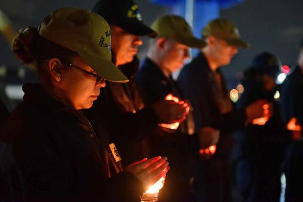 Chief Religious Programs Specialist Ana Douglas, attached to U.S. 7th Fleet flagship USS Blue Ridge (LCC 19), attends a candlelight vigil in Yokosuka, Japan, in observance of Suicide Prevention month on Sept. 27, 2018. (U.S. Navy photo by Mass Communication Specialist 2nd Class Patrick Semales)