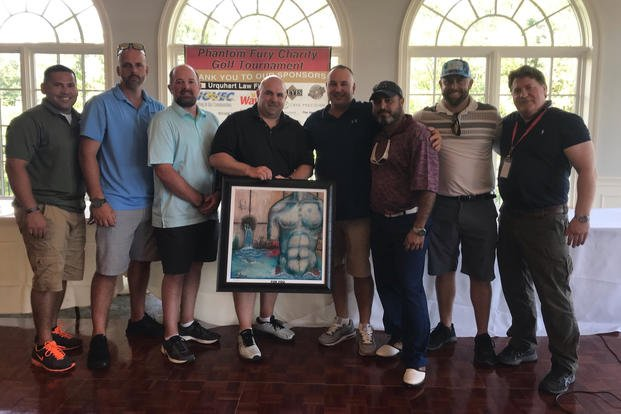 Jake Edwards, second from right, organized a golf tournament to raise funds for the Phantom Fury reunion he organized 15 years after the Second Battle of Fallujah. Also pictured, from left to right: Alex Gonzales, Jack Crandall, Jonathon Allen, Jon-Paul Grizzle, Ryan Cantore, Adel Abudeyah and Pat O'Donnell. (Courtesy of Jake Edwards)