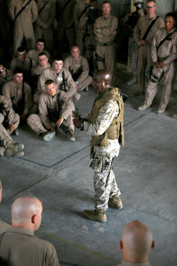 Sgt. Maj. Carlton W. Kent, sergeant major of the Marine Corps, visits Marines from Echo Company, 2nd Battalion, 6th Marines, at Observation Post Sina'a in Al Fallujah, Iraq, on Sept. 23, 2007. Kent traveled throughout the Al Anbar province of Iraq meeting with Marines and service members currently deployed with II Marine Expeditionary Force. II MEF is deployed with Multi National Forces-West in support of Operation Iraqi Freedom in the Al Anbar province of Iraq to develop Iraqi security forces, facilitate t