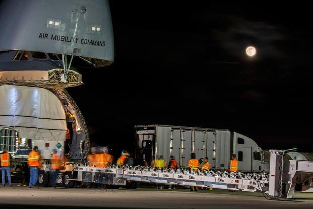 AEHF-5 communications satellite onto a C-5M Super Galaxy