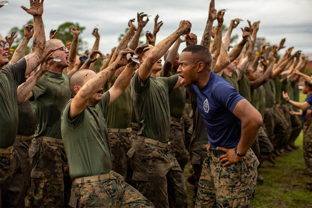 A drill instructor yells at Marine Corps recruits.