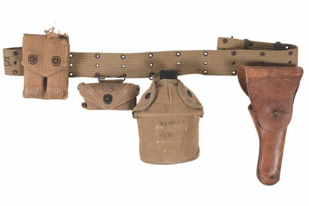 Rock Island Auction Company will auction this pistol belt rig and 1911 Colt .45 automatic pistol.