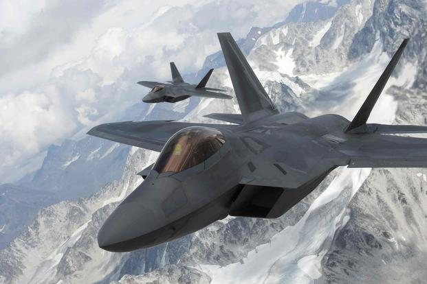 U.S. Air Force F-22 Raptors  fly in formation over the Joint Pacific Alaska Range Complex.