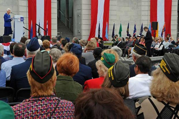 Veterans gather for the 15th anniversary dedication of the Women in Military Service for America Memorial.