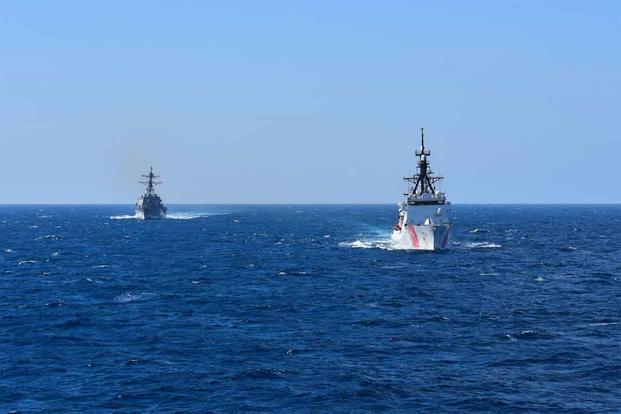 USS Roosevelt and USCGC Hamilton.