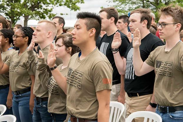 Recruits at Grissom Air Reserve Base, Indiana recite the oath of enlistment and join the military.