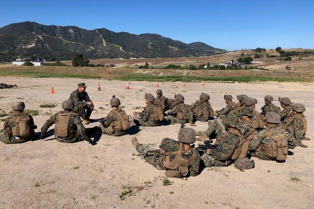 combat instructor chats with Marine infantrymen rifle range at Camp Pendleton