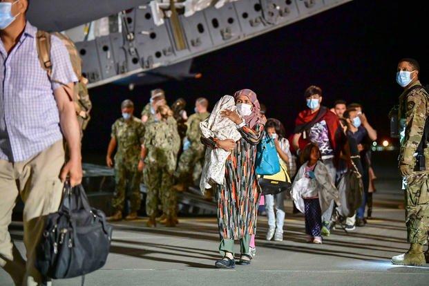 Afghan evacuees disembark a U.S. Air Force C-17 Globemaster III.