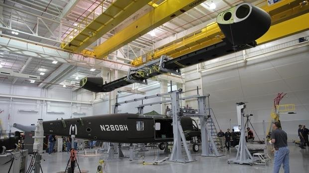 Bell Helicopter's wing is lowered to be attached to the fuselage of its V-280 Valor tilt-rotor helicopter in April 2016 at the company's aircraft assembly center in Amarillo, Texas. (Bell photo)