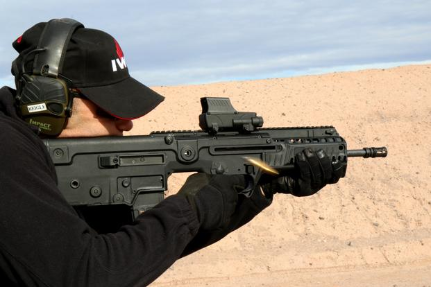 Israeli Weapons Industries US Inc., displayed new features on the 5.56mm Tavor rifle during SHOT Show's range day outside Las Vegas, Jan. 18, 2016. (Photo by Matthew Cox/Military.com)