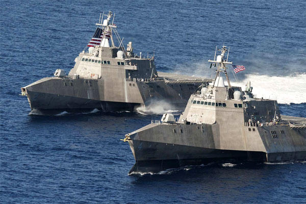 The littoral combat ships USS Independence (LCS 2), left, and USS Coronado (LCS 4) are underway in the Pacific Ocean. The Navy has been authorized to build a 13th ship in the class. (US Navy/Keith DeVinney)