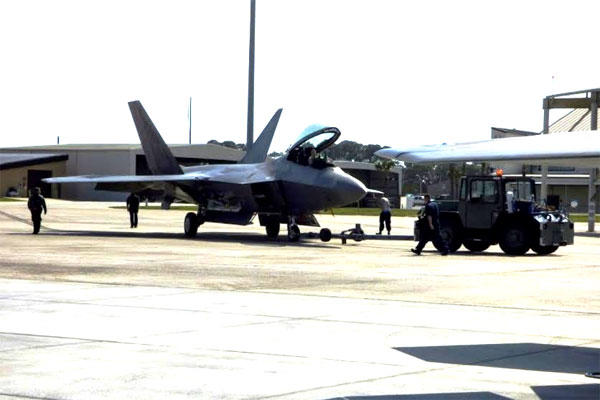 An F-22 Raptor is towed to its hangar on Feb. 27 at Tyndall Air Force Base, Fla. (Military.com photo/Oriana Pawlyk)