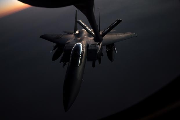 A U.S. Air Force F-15E Strike Eagle is refueled by a KC-135 Stratotanker on May 23, during flight operations in support of Operation Inherent Resolve. (U.S. Air Force photo/Trevor McBride)