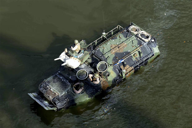Marines train on board an AAV-7 amphibious assault vehicle during an exercise last month on the Cumberland River. Fifteen Marines and one sailor were injured when their AAV-7 caught fire Sept. 13 at Camp Pendleton, Calif. (US Marine Corps/Jack Rigsby)